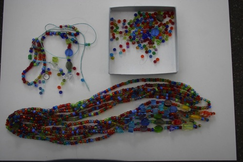 Gorgeous rainbow lariat necklace where a strand broke